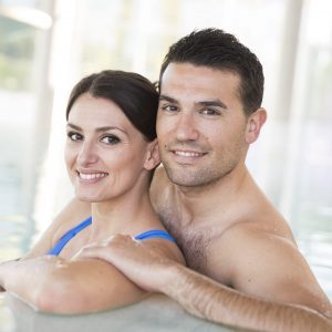 Young couple relaxing in thalassotherapy thermal water